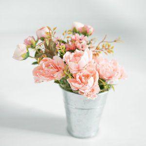 Floral arrangement + tin vase